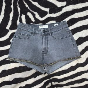 High waisted denim shorts with tribal trimming